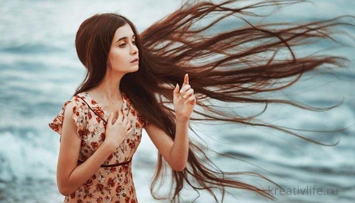 Девушка с красивыми, густыми, длинными волосами